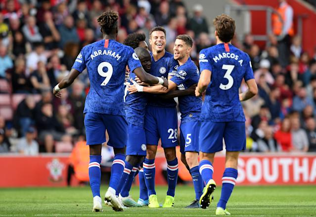 Chelsea players celebrate N'Golo Kante's first-half goal Sunday en route to a 4-1 win at Southampton. (Darren Walsh/Getty)