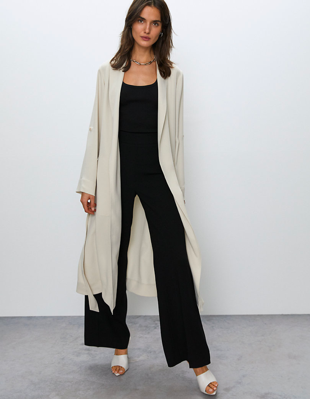 "The next best thing to wearing your bathrobe out and about, though we don't blame you for that one either. $228, Aritzia. <a href=""https://www.aritzia.com/us/en/product/kahlo-robe/61711.html?dwvar_61711_color=5864"" rel=""nofollow noopener"" target=""_blank"" data-ylk=""slk:Get it now!"" class=""link rapid-noclick-resp"">Get it now!</a>"