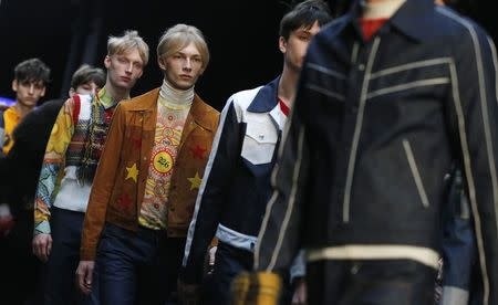 """Models present creations from the Topman Design Autumn/Winter 2015 collection during """"London Collections: Men"""" in London January 9, 2015. """"London Collections: Men"""" is a four-day showcase of men's fashion scheduled a month before London Fashion week. REUTERS/Suzanne Plunkett"""