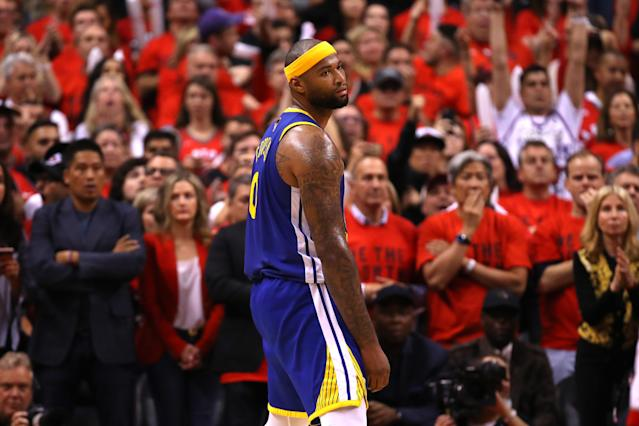 DeMarcus Cousins was called for a basket interference late in Game 5 of the NBA Finals on Monday night, though many weren't happy with the call. (Gregory Shamus/Getty Images)
