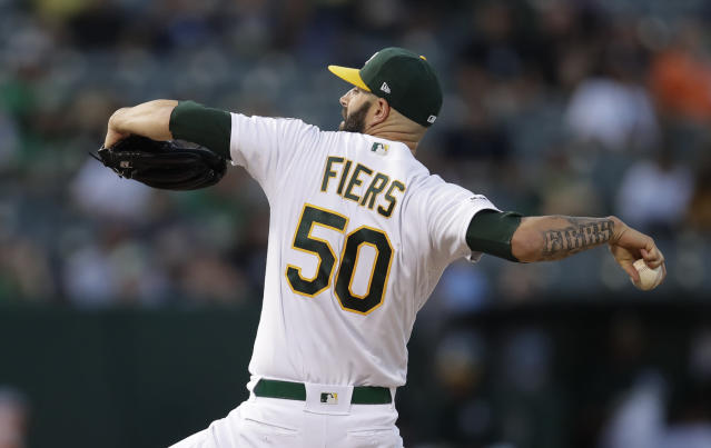 Oakland Athletics pitcher Mike Fiers works against the New York Yankees during the first inning of a baseball game Wednesday, Aug. 21, 2019, in Oakland, Calif. (AP Photo/Ben Margot)