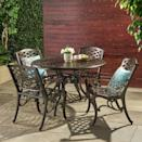 <p>The antique bronze finish on the <span>Hallandale Sarasota Cast Aluminum Patio Dining Set</span> ($800) is so pretty.</p>
