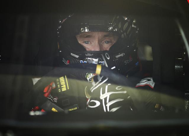 Driver Mark Martin sits in his car during practice for Sunday's NASCAR Sprint Cup series auto race Friday, Nov. 15, 2013, at Homestead-Miami Speedway in Homestead, Fla.(AP Photo/J Pat Carter)