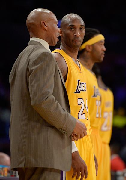 LOS ANGELES, CA - JANUARY 15: Kobe Bryant #24 of the Los Angeles Lakers talks with Head Coach Byron Scott during a 109-102 loss to the Cleveland Cavaliers at Staples Center on January 15, 2015 in Los Angeles, California. NOTE TO USER: User expressly acknowledges and agrees that, by downloading and or using this Photograph, user is consenting to the terms and condition of the Getty Images License Agreement. (Photo by Harry How/Getty Images)