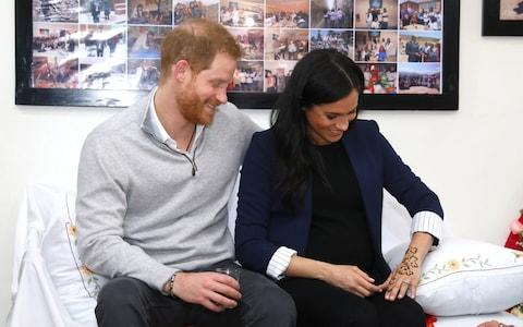 Prince Harry, Duke of Sussex and Meghan, Duchess of Sussex during a Henna ceremony - Credit: Getty