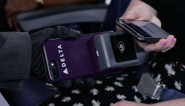 PHOTO: Starting March 16, Delta will allow customers to use tap-to-pay technology that the airline says will enable contactless payment for onboard purchases. (American Airlines)