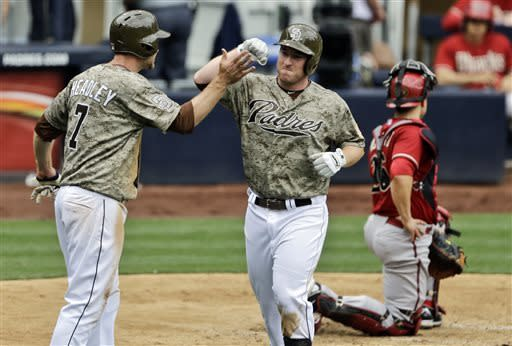 San Diego Padres' Jedd Gyorko is congratulated by Chase Headley after his two-run home run against the Arizona Diamondbacks in the sixth inning of a baseball game in San Diego, Sunday, May 5, 2013. (AP Photo/Lenny Ignelzi)