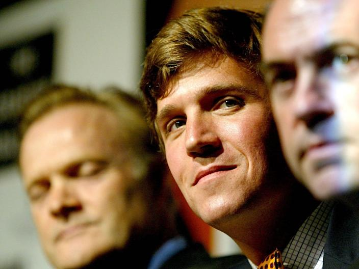 Lawrence O'Donnell, Tucker Carlson, and Governor Mike Huckabee of Arkansas take part in a panel discussion on August 31, 2004, in New York City.