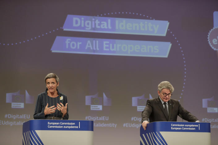 European Commissioner for Europe fit for the Digital Age Margrethe Vestager, left, and European Commissioner for Internal Market Thierry Breton participate in a media conference at EU headquarters in Brussels, Thursday, June 3, 2021. The European Union unveiled plans Thursday for a digital ID wallet that residents can use to access services across the bloc, in an effort to accelerate the shift to online for its post-pandemic recovery strategy. (Stephanie Lecocq, Pool via AP)