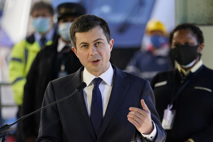 FILE - In this Friday, Feb. 5, 2021 file photo, Transportation Secretary Pete Buttigieg speaks at Union Station in Washington. Airline officials are talking to the Biden administration about support for incentives to use cleaner fuels for airplanes. Leaders of several of the largest U.S. passenger and cargo airlines held an online meeting Friday, Feb. 26, 2021 with White House climate adviser Gina McCarthy and Transportation Secretary Pete Buttigieg.(AP Photo/Carolyn Kaster, File)