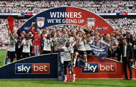 Soccer Football - Championship Play-Off Final - Fulham vs Aston Villa - Wembley Stadium, London, Britain - May 26, 2018 Fulham celebrate promotion to the Premier League with the trophy Action Images via Reuters/Tony O'Brien