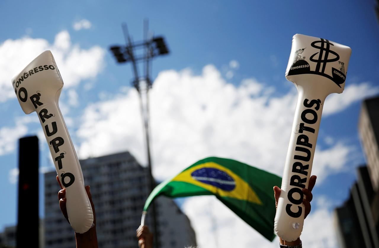 "A woman holds inflatable signs that read ""The Congress is Corrupt"" takes part in a protest against corruption at Paulista Avenue in Sao Paulo, Brazil, December 4, 2016. REUTERS/Nacho Doce"