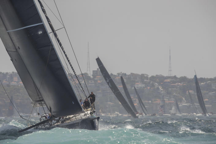 Black Jack heads to the outside marker during the start of the Sydney Hobart yacht race on Sydney Harbour, Thursday, Dec. 26, 2019. (AP Photo/Steve Chirsto)