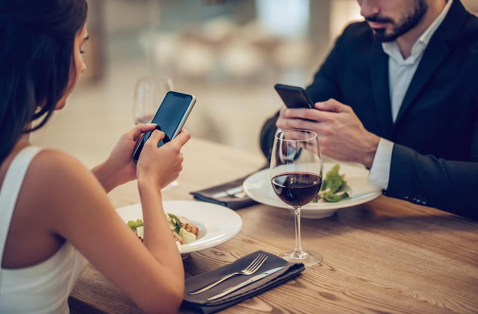 Using your phone on a date is another faux-pas. (Getty Images)