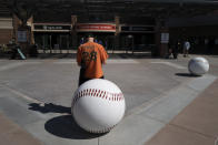 Dan Munson, 37, of Atlanta, waits for the gates to open at Scottsdale Stadium before a spring baseball game between the San Francisco Giants and the Los Angeles Angels in Scottsdale, Ariz., Sunday, Feb. 28, 2021. (AP Photo/Jae C. Hong)