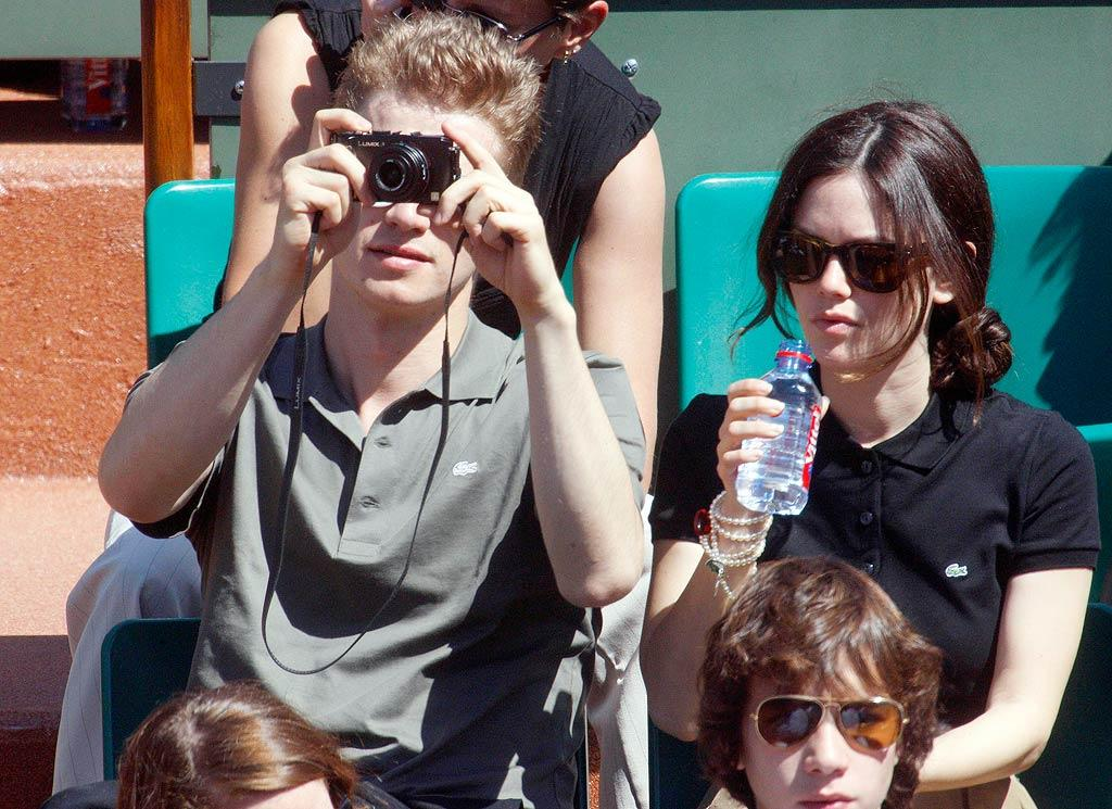 """The engaged sweethearts take in a match wearing matching Lacoste polo shirts. Who knew they were so preppy? KCSPresse/<a href=""""http://www.splashnewsonline.com/"""" target=""""new"""">Splash News</a> - May 29, 2009"""