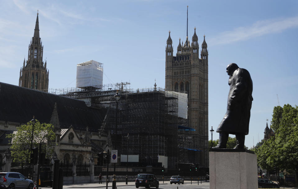 The statue of Britain's former Prime Minister Winston Churchill stands by Parliament in London, Tuesday, June 2, 2020. The British government has decided to scrap a remote-voting system used during the coronavirus pandemic, and has summoned lawmakers back to parliament on Tuesday, but many aren't happy with the arrangements. (AP Photo/Frank Augstein)