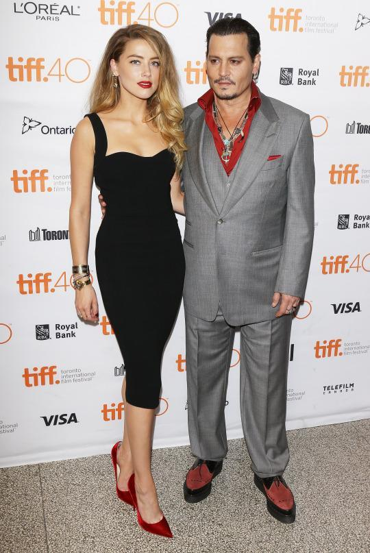 "<p>After seeing Amber Heard in one of her dresses, Victoria Beckham took to Instagram to share her excitement. In a picture from the red carpet, she wrote that the actress looked beautiful in one of her favorite dresses from her Resort 2016 collection. Heard paired the fitted black dress with red heels and a matching red statement lip. Her husband, Johnny Depp, opted for the same color scheme in a gray suit from Tom Ford with a red button down at the ""Black Mass"" premiere in Toronto.</p>"