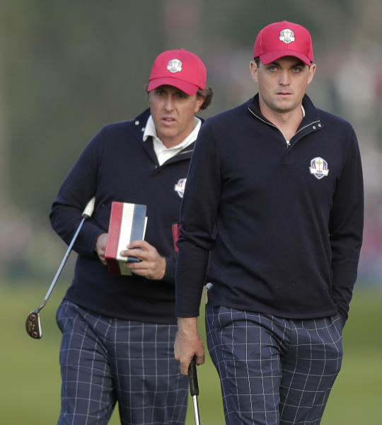 USA's Phil Mickelson, left, and Keegan Bradley look over a shot on the first hole during a foresomes match at the Ryder Cup PGA golf tournament Friday, Sept. 28, 2012, at the Medinah Country Club in Medinah, Ill. (AP Photo/Charlie Riedel)