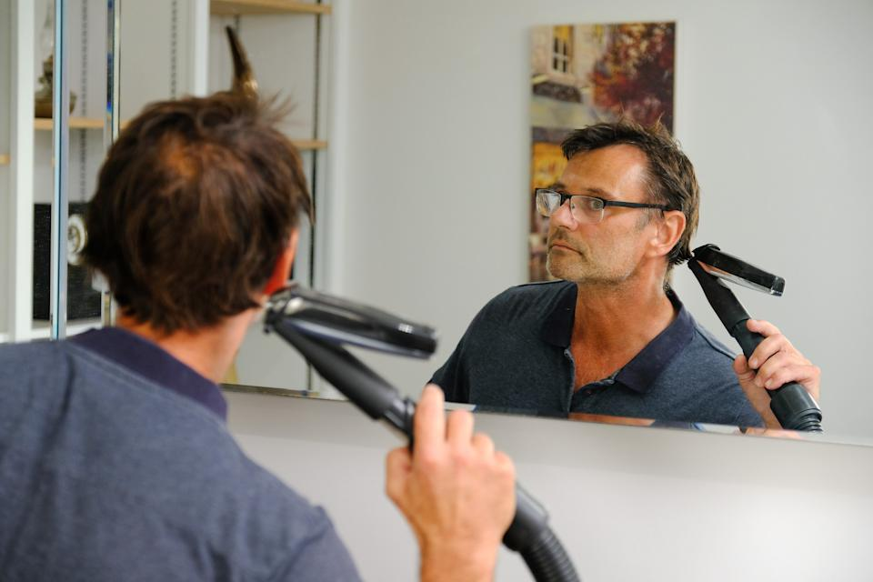 Dr Phil Green has designed a simple invention that enables users to cut their own hair. (SWNS)