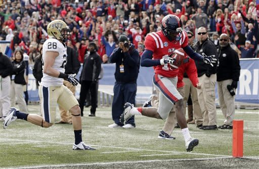 Mississippi wide receiver Vince Sanders (10) scores a touchdown as Pittsburgh defensive back Anthony Gonzalez (28) pursues during the first half of the BBVA Compass Bowl NCAA college football game at Legion Field in Birmingham, Saturday, Jan. 5, 2013. (AP Photo/Dave Martin)