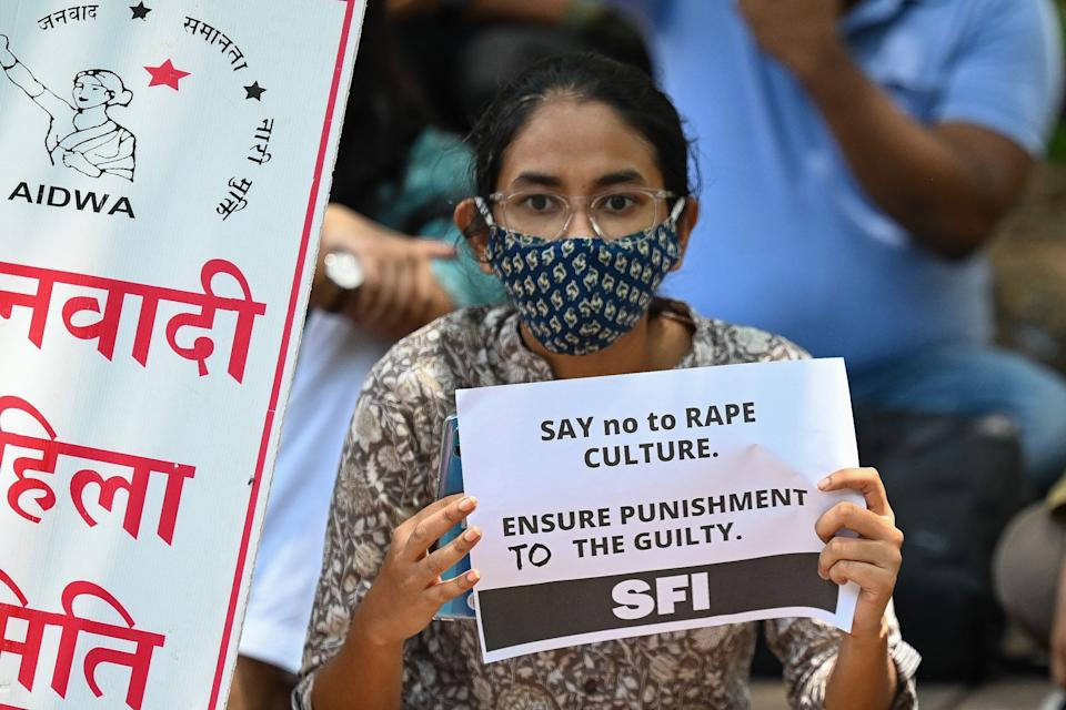 Activists of Student Federation of India (SFI) and All India Democratic Women's Association (AIDWA) hold placards during a protest against the alleged rape and murder of a nine-year-old girl, in New Delhi on August 4, 2021. (Photo by Prakash SINGH / AFP) (Photo by PRAKASH SINGH/AFP via Getty Images)
