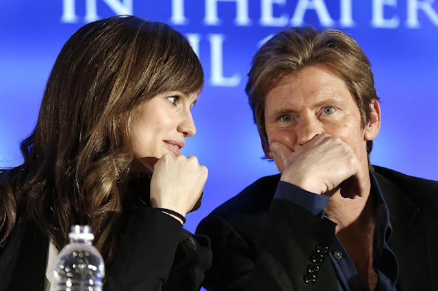 "Actors Jennifer Garner and Denis Leary talk during an appearance at a news conference for the movie ""Draft Day"" in New York on Friday, Jan. 31, 2014. (AP Photo/Paul Sancya)"