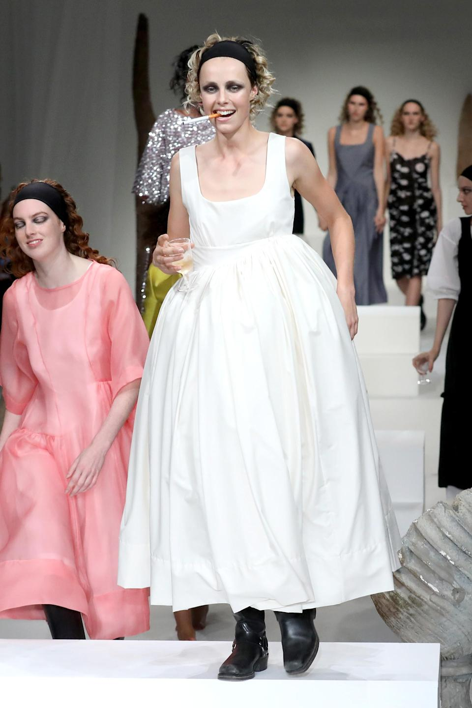 <p>Maybe we can't see the Duchess of Cambridge with a cigarette hanging out of her mouth — but we can see her in this voluminous frock. </p>