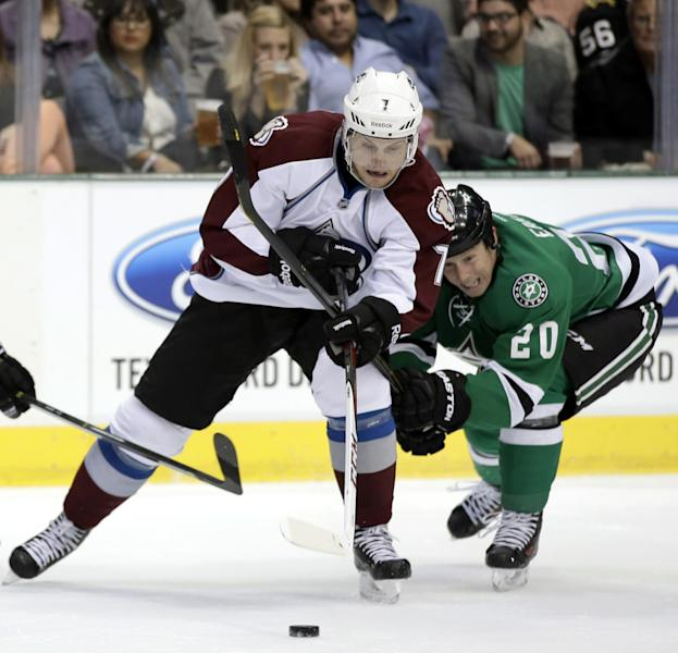 Colorado Avalanche center John Mitchell (7) and Dallas Stars center Cody Eakin (20) compete for control of a loose puck in the first period of a preseason NHL hockey game on Thursday, Sept. 26, 2013, in Dallas. (AP Photo/Tony Gutierrez)