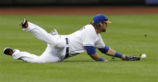 New York Mets center fielder Kirk Nieuwenhuis (9) comes up short fielding Pete Kozma's fifth-inning double in a baseball game against the St. Louis Cardinals in New York, Thursday, June 13, 2013. (AP Photo/Kathy Willens)