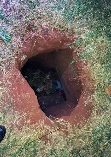 Handout picture released by Paraguay's ABC TV showing the end of the tunnel through which 76 inmates allegedly escaped from the prison in Pedro Juan Caballero, 500 kilometers northeast of Asuncion