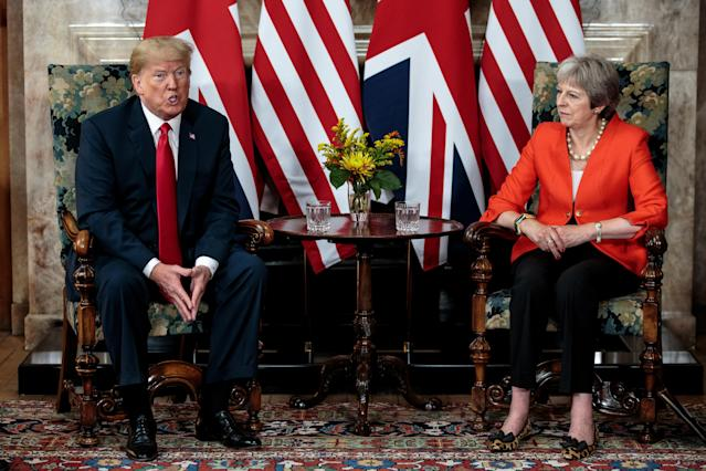 <p>Britain's Prime Minister Theresa May poses for photographs with U.S. President Donald Trump at Chequers near Aylesbury, Britain, July 13, 2018. (Photo: Jack Taylor/Pool via Reuters) </p>
