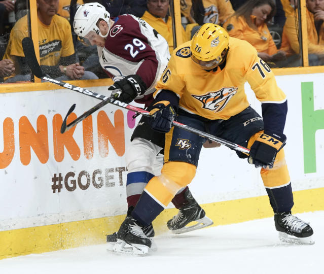 Colorado Avalanche center Nathan MacKinnon (29) battles for the puck with Nashville Predators defenseman P.K. Subban (76) during the first period in Game 5 of an NHL hockey first-round playoff series Friday, April 20, 2018, in Nashville, Tenn. (AP Photo/Sanford Myers)