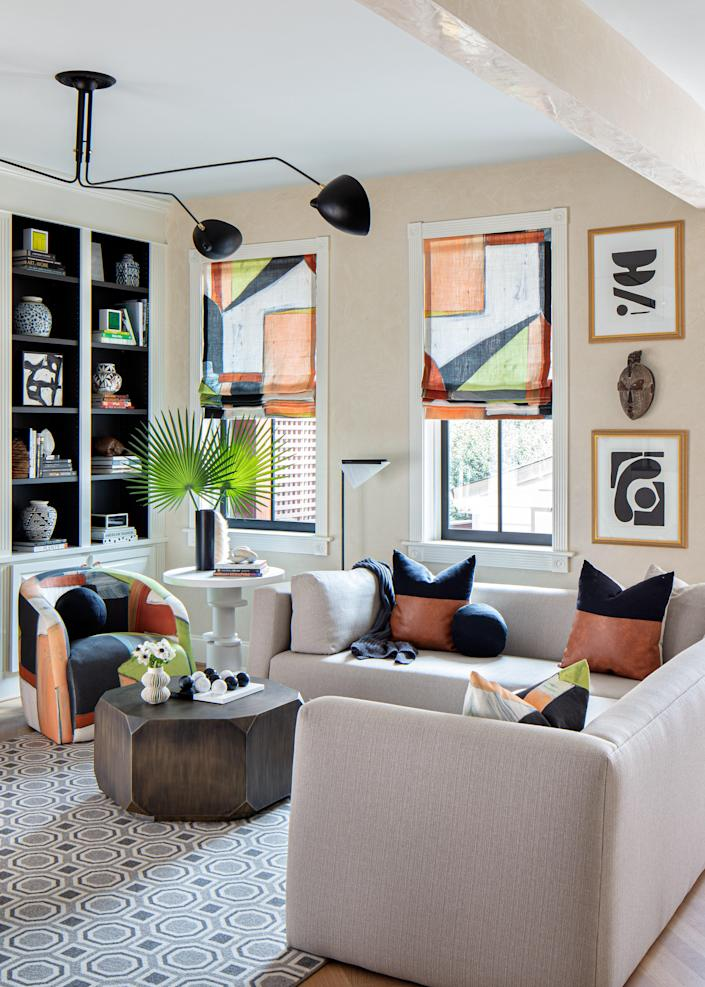 """Graphics were introduced into the family room by applying Lindsay's vibrant Maya Belgian Linento a Verellen chair and the Roman shades. """"Pattern doesn't have to be everywhere, but you do need some pattern in a room,"""" Lindsay says."""