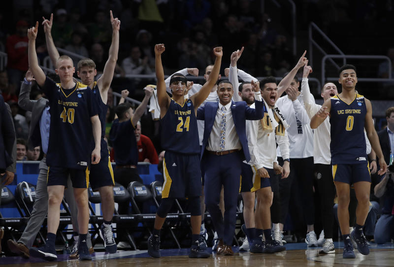 UC Irvine players and coaches celebrate during the second half of a first round men's college basketball game against Kansas State in the NCAA Tournament, Friday, March 22, 2019, in San Jose, Calif. (AP Photo/Ben Margot)