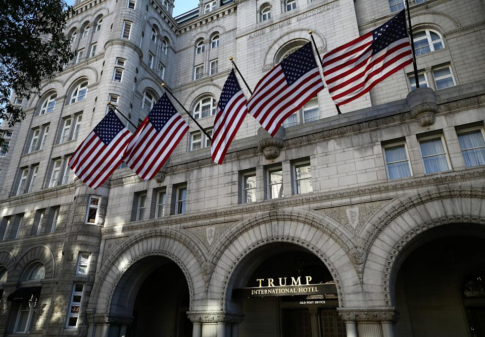 US flags are seen at the entrance to the Turmp International Hotel at Pennsylvania Avenue in DC. Source: Getty