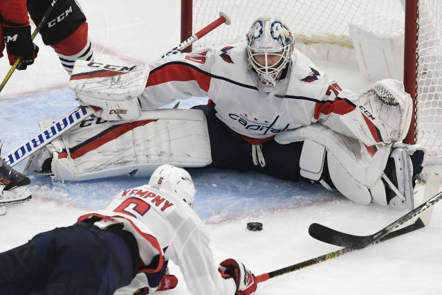 Washington Capitals goalie Braden Holtby (70) makes a save during the second period of an NHL hockey game against the Chicago Blackhawks, Sunday, Oct. 20, 2019, in Chicago. Chicago won 5-3. (AP Photo/Paul Beaty)