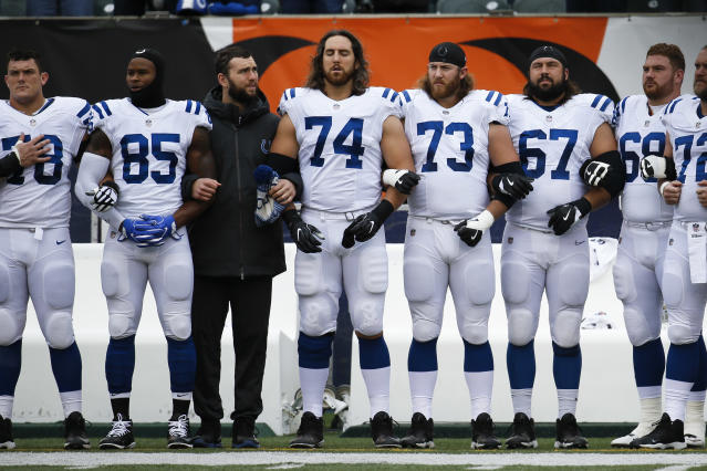 Quuarterback Andrew Luck, third from left, may not be back in uniform with his Colts teammates in 2017. (AP)