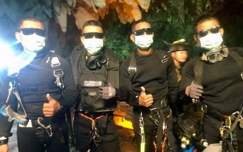<span>Four Thai Navy Seals are seen after leaving the cave safe during the rescue mission, Chiang Rai Province</span> <span>Credit: Reuters </span>