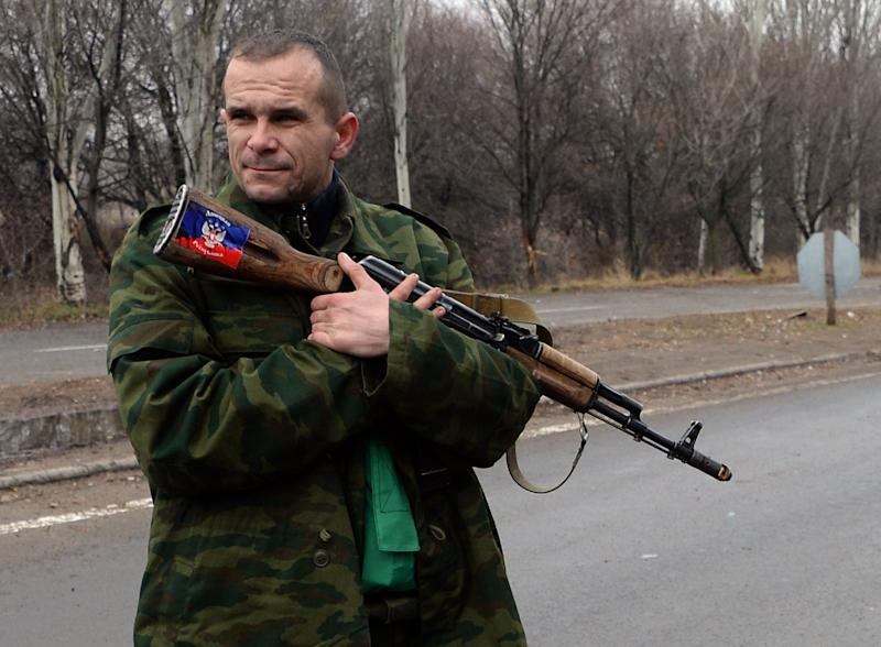 A supporter of the self-proclaimed People's Republic of Donetsk mans a checkpoint in the city of Horlivka near Donetsk on December 13, 2014
