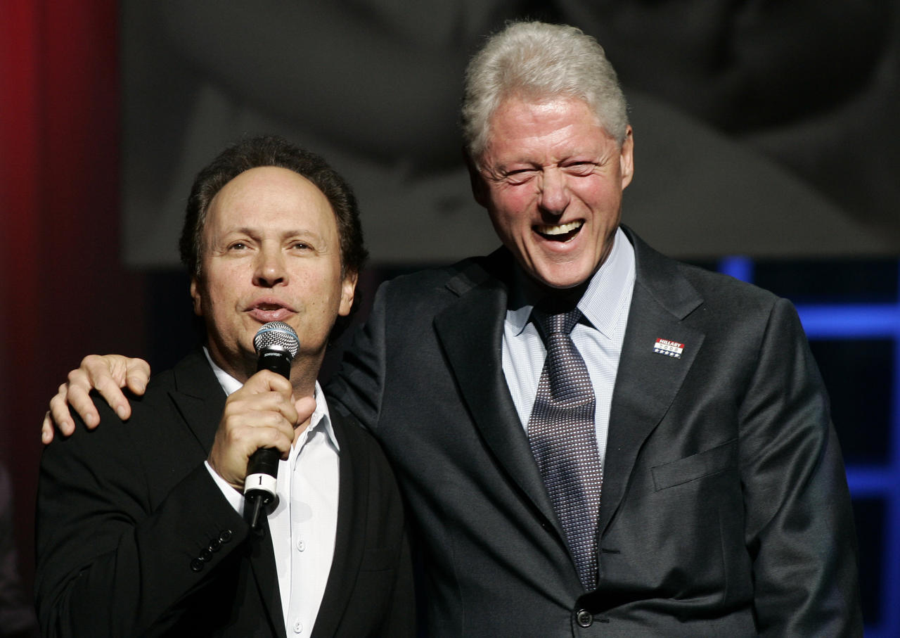 Former U.S. president Bill Clinton (R) smiles with actor Billy Crystal during Democratic presidential candidate and U.S. Senator Hillary Clinton's (D-NY) 60th birthday celebration at the Beacon Theater in New York October 25, 2007. (	 REUTERS/Shannon Stapleton)