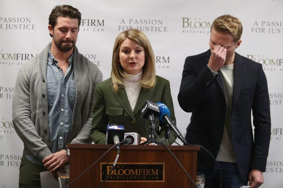 Attorney Lisa Bloom (C) speaks during a press conference with her clients, models Mark Ricketson (L) and Jason Boyce (Frederick M. Brown/Getty Images)