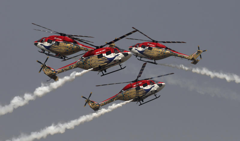 Indian Air Force Saranng helicopters display their skills during Air Force Day parade at Hindon Air Force Station on the outskirts of New Delhi, India, Thursday, Oct. 8, 2020. (AP Photo/Manish Swarup)