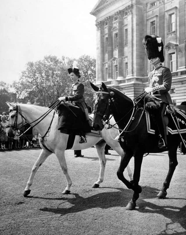 Philip, seen with the Queen, attended Trooping the Colour on horseback until he was 82 (Archive/PA)