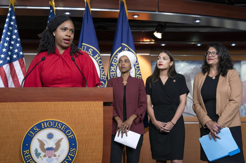 "FILE - In this July 15, 2019 file photo, from left, Rep. Ayanna Pressley, D-Mass., Rep. Ilhan Omar, D-Minn., Rep. Alexandria Ocasio-Cortez, D-N.Y., and Rep. Rashida Tlaib, D-Mich., respond during a news conference at the Capitol in Washington, to remarks by President Donald Trump after his call for the four Democratic congresswomen to go back to their ""broken"" countries. All are American citizens. Pressley, the only one of the four who has yet to back any of the Democrats seeking the party's nomination for president in 2020, told the Associated Press, Monday, Nov. 4, that several top party candidates are seeking her endorsement. (AP Photo/J. Scott Applewhite, File)"
