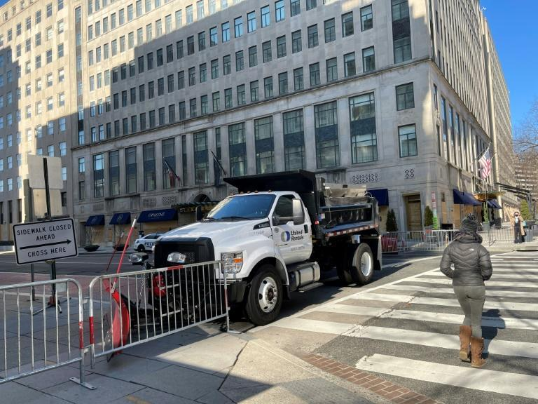 A truck used as a temporary security barrier on a street near the White House