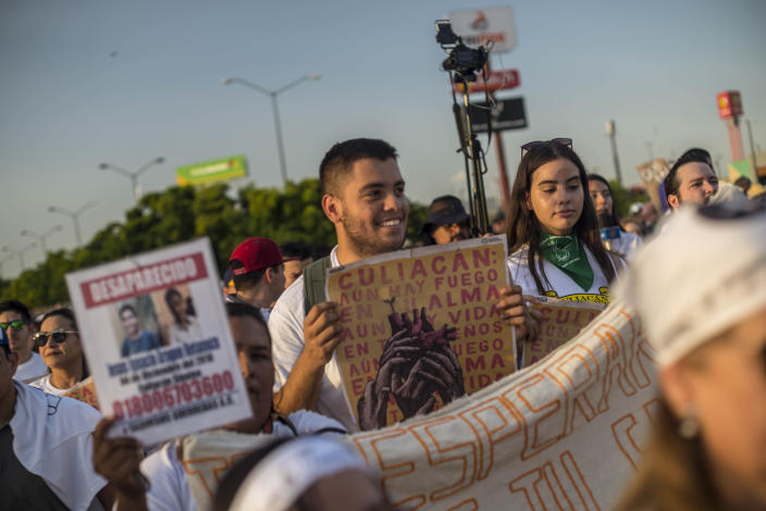 """People attend a march coined """"Culiacan Valiente,"""" or Brave Culiacan, to protest violence and demand safety in Culiacan, Mexico, Sunday, Oct. 27, 2019. Residents are still coming to grips with the worst cartel violence in recent memory, in which 13 people were killed including at least three innocents caught in the crossfire, on Oct. 17, a date now known as """"black Thursday."""" (AP Photo/Augusto Zurita)"""
