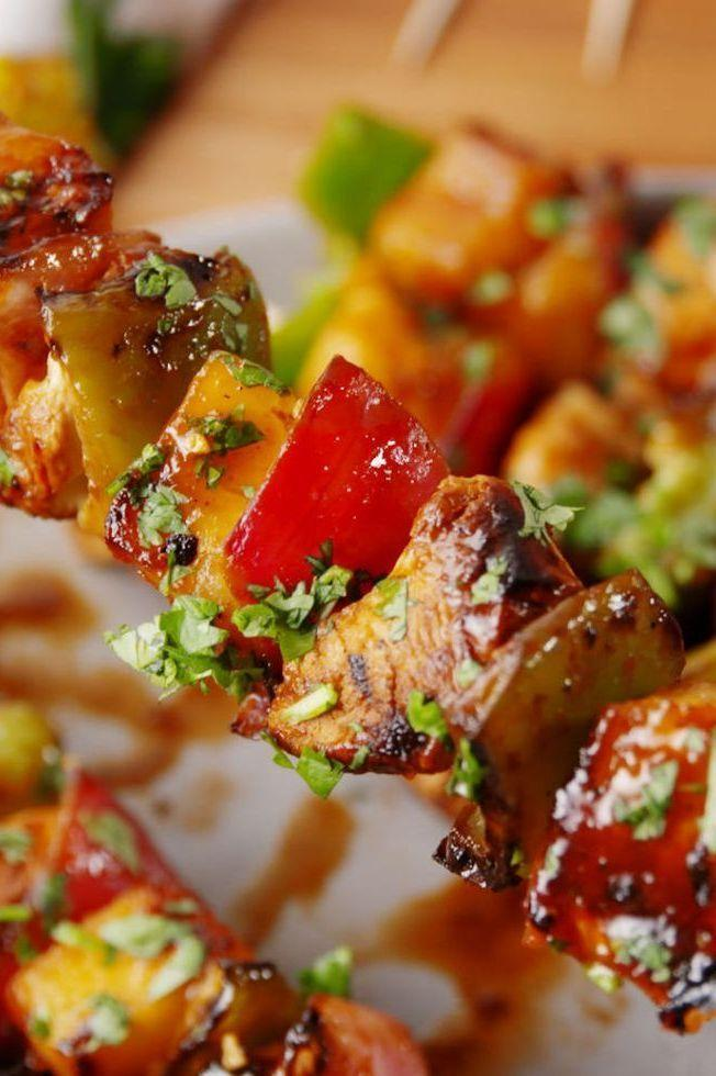 """<p>Say aloha to your new favourite BBQ skewers. </p><p>Get the <a href=""""https://www.delish.com/uk/cooking/recipes/a32399748/hawaiian-chicken-skewers-recipe/"""" rel=""""nofollow noopener"""" target=""""_blank"""" data-ylk=""""slk:Hawaiian Chicken Skewers"""" class=""""link rapid-noclick-resp"""">Hawaiian Chicken Skewers</a> recipe.</p>"""