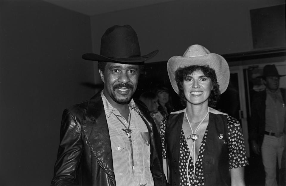 19th May 1979:  American comedian and actor Richard Pryor and his future wife, Jennifer Lee, wearing cowboy hats and bolo ties, smile while at the annual SHARE party, held at the Hollywood Palladium, Hollywood, California.  (Photo by Bob V. Noble/Fotos International/Getty Images)