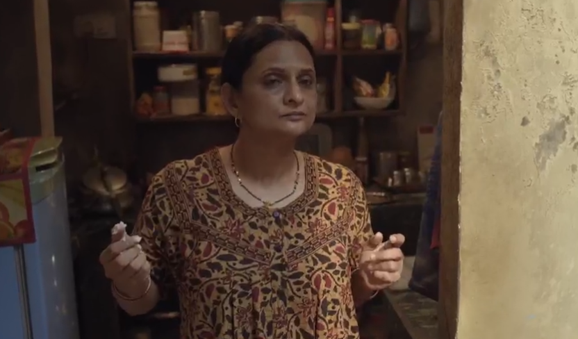 """Unlike the doting, sacrificing mothers one is used to in our serials and movies, Kulkarni's shade-throwing Shanti or """"Mummy"""" for all practical purposes in this endearing TVF series is utterly delightful. She tells her sass-mouth sons off, lists out chores for her husband, and doesn't miss an opportunity to fake boast about her family's prospects – all while running a strapped but close-knit household."""
